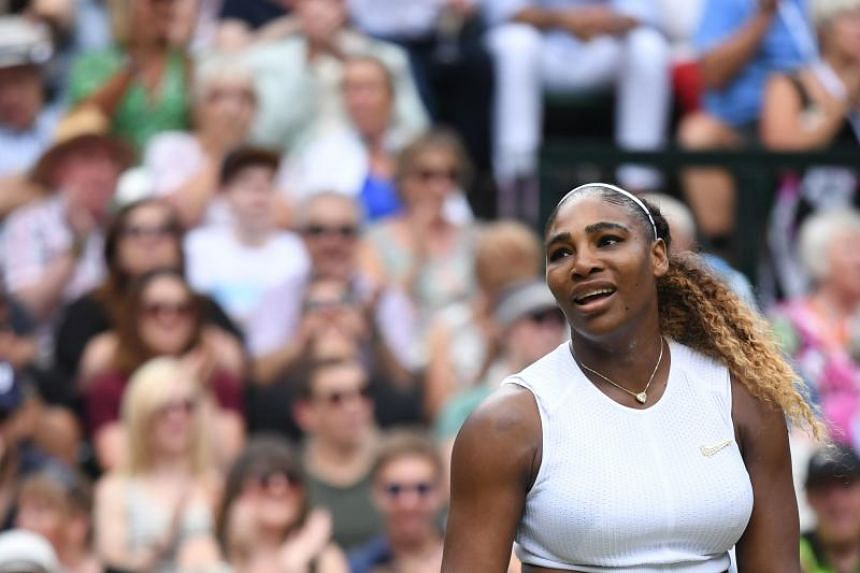 In this photo taken on July 13, 2019, US player Serena Williams reacts after a point against Romania's Simona Halep during their women's singles final at the 2019 Wimbledon Championships.