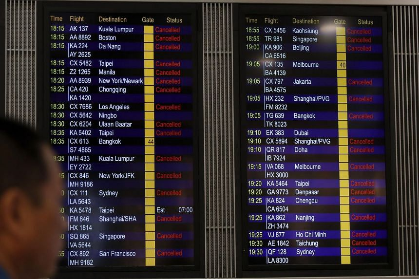 An electronic board showing cancelled flights at Hong Kong's international airport on Aug 12, 2019. Six flights from Singapore to Hong Kong were cancelled as a result of the sit-in.