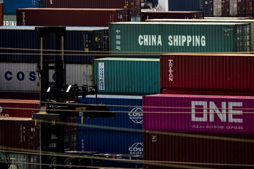 Containers reading 'China Shipping' and 'Cosco Shipping' (China Ocean Shipping Company) sit on the docks at the Los Angeles Port in Los Angeles, California, USA, on Aug 8, 2019.