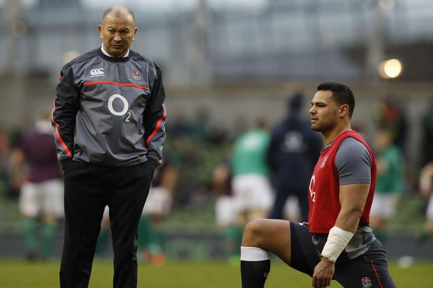 In this photo taken on March 18, 2017, England's head coach Eddie Jones (left) stands by England's Ben Te'o ahead of the Six Nations international rugby union match between Ireland and England at the Aviva Stadium in Dublin.