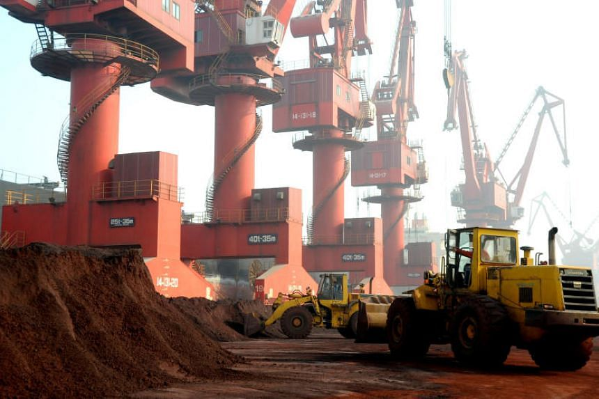 In a photo taken on Oct 31, 2010, workers transport soil containing rare earth elements for export at a port in Lianyungang, China.