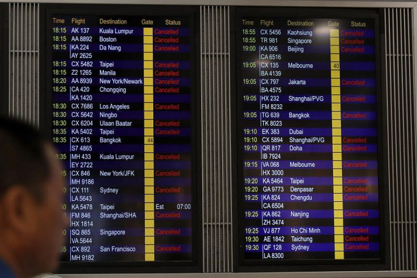 A flight information board shows outbound flights canceled at the Hong Kong International airport on Aug 12, 2019.