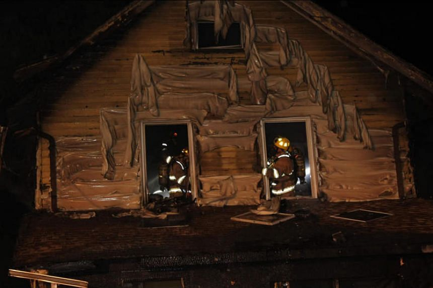 Firefighters work to put out a fire that occurred in a home daycare in Erie, Pennsylvania on Aug 11, 2019.