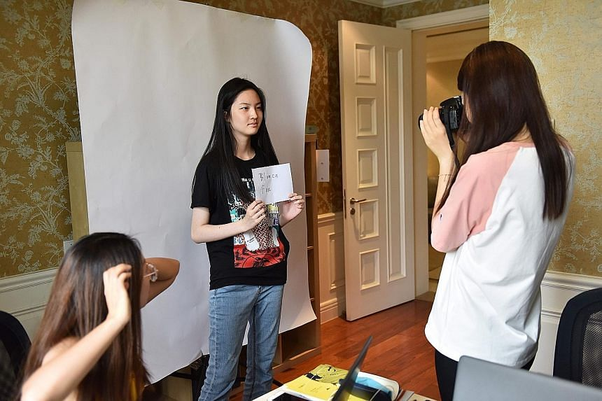Left: Student Blanca Fan having her portrait taken at Elite Scholars China, a college consultancy in Beijing. Above: College counsellor Mackenzie Bell (centre) with students at Elite Scholars China who are aiming to enter foreign universities. PHOTOS