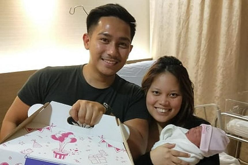 Left: Mr Kamarulnizam Kiman and Ms Nur Syazwani Muhammad Rosdi with their daughter Mia. Below: Mr Kamarulnizam cradling the infant in the Grab car she was born in last Wednesday on the way to the hospital for her delivery. PHOTOS: LIANHE ZAOBAO, KAMA