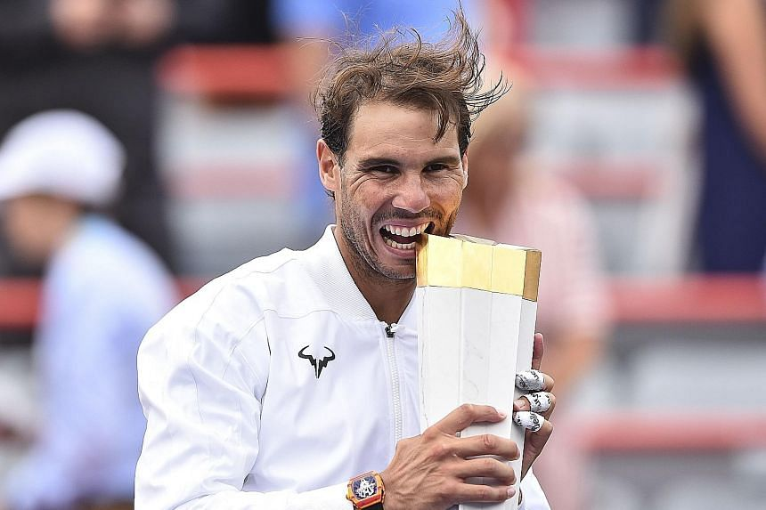 Rafael Nadal of Spain posing with the Rogers Cup after a demolition job on Russia's Daniil Medvedev in Sunday's final in Montreal. PHOTO: AGENCE FRANCE-PRESSE