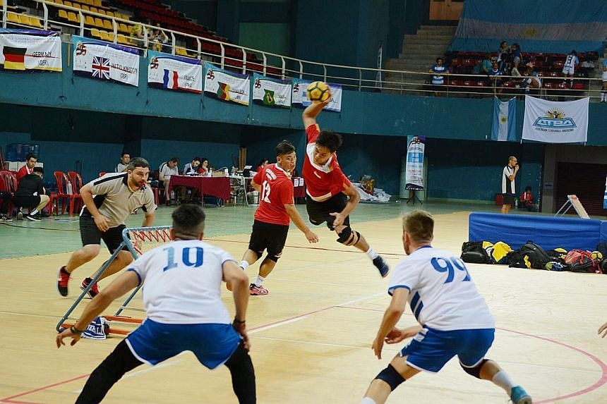 Singapore's Nico Quek (with the ball) and Low Ee Tuck attempting to score in their 55-53 loss to Italy at the World Tchoukball Championships semi-final in Negeri Sembilan. Singapore won the bronze by defeating Macau in the third-place play-off. PHOTO
