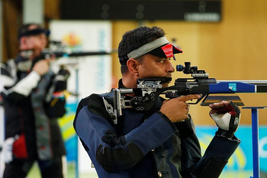 In a picture from April 14, 2018, India's Sanjeev Rajput takes part in the Men's 50m Rifle 3 Positions, in Australia.