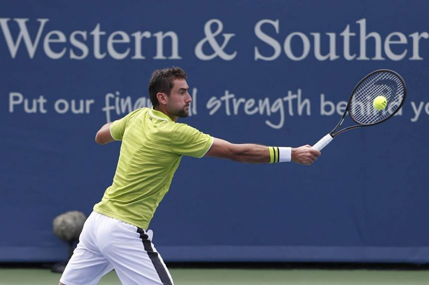 Marin Cilic returns a backhand during first round play match at the Western & Southern Open tennis tournament, in Mason, Ohio, on Aug 12, 2019.