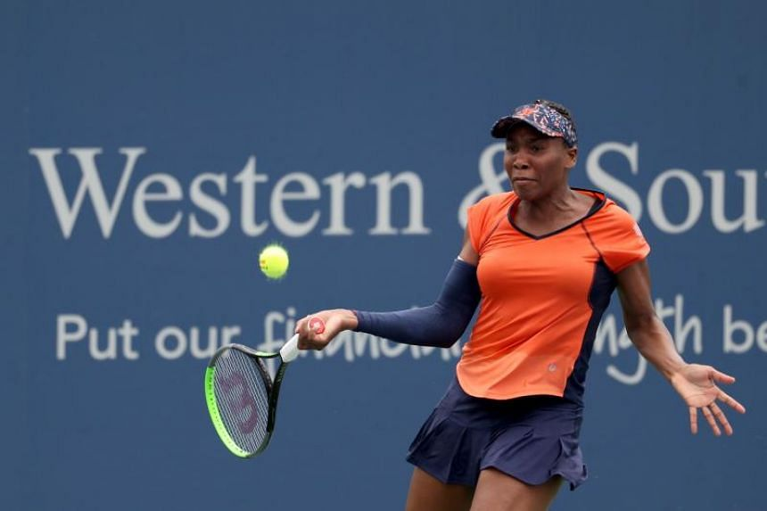 Venus Williams of the United States returns a shot to Lauren Davis of the United States during Day 3 of the Western and Southern Open at Lindner Family Tennis Centre, on Aug 12, 2019 in Mason, Ohio.