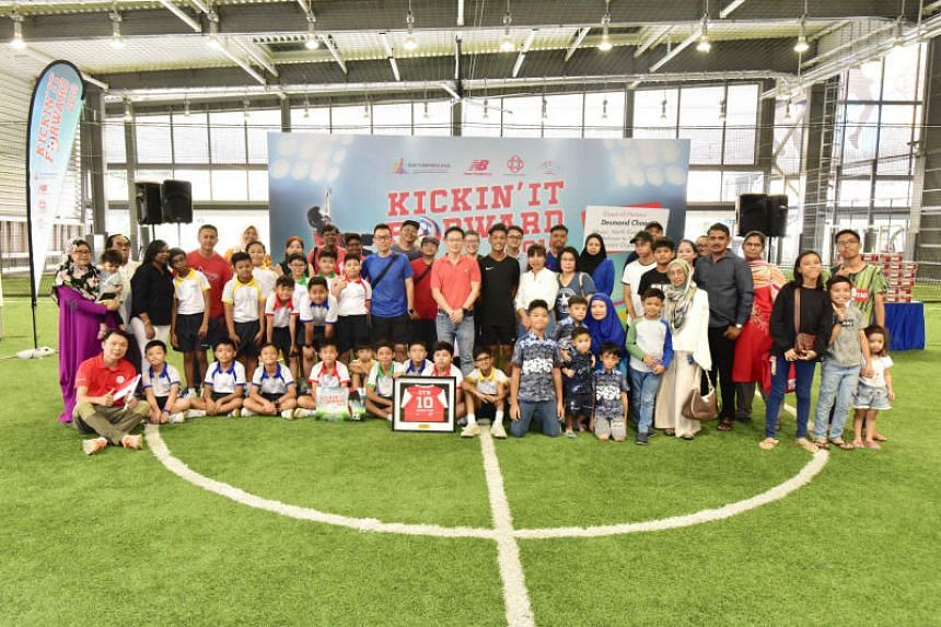 The children and their families at the futsal courts at Our Tampines Hub.