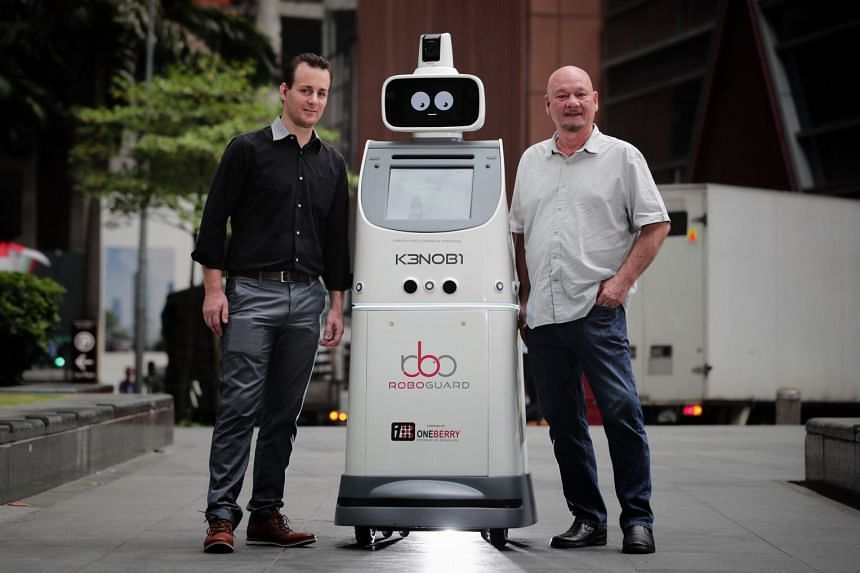 KenOBI the RoboGuard, an autonomous security, concierge and events robot that augments and enhances the work of security officers, with Oneberry CEO Ken Pereira (right) and CTO Julien Lenser-Hobbs.
