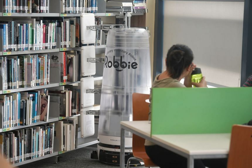 Robot Robbie at work in Temasek Polytechnic's library. The workhorse saves library officers 16 man-hours a day so they can undertake less tedious work.