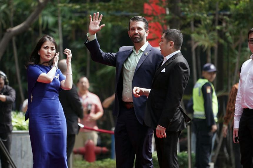 Donald Trump Jr waves as he stands next to Indonesian business tycoon Hary Tanoesoedibjo, right, prior to a news conference in Jakarta, Indonesia, on Aug 13, 2019. Mr Tanoesoedibjo's MNC Land is investing US$$1.7 billion to develop two sites, inclu