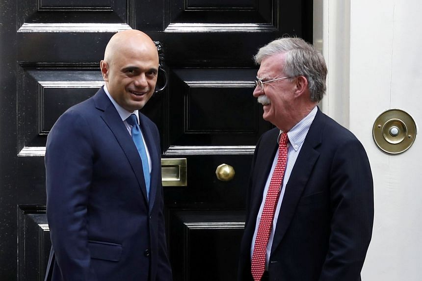 Britain's Chancellor of the Exchequer Sajid Javid meets US National Security Advisor John Bolton at Downing Street in London.