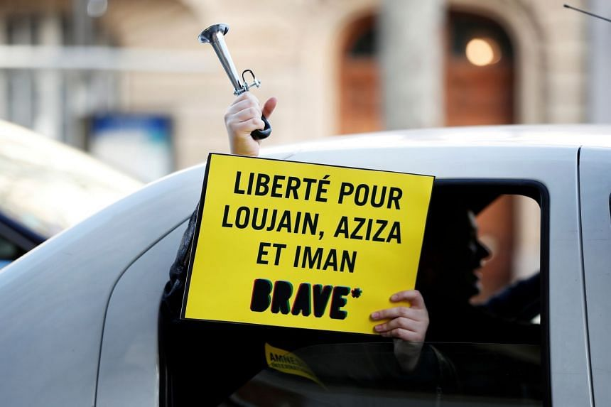 A demonstrator holds a placard outside the Saudi Arabian Embassy in Paris to demand the release of jailed women's rights activists Loujain al-Hathloul, Eman al-Nafjan and Aziza al-Yousef.