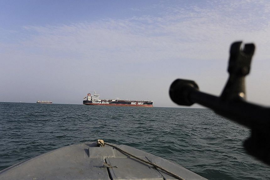 In this photo taken on July 21, an Iranian Revolutionary Guard boat has its sights trained on British oil tanker Stena Impero, which was seized in the Strait of Hormuz on July 19. PHOTO: ASSOCIATED PRESS