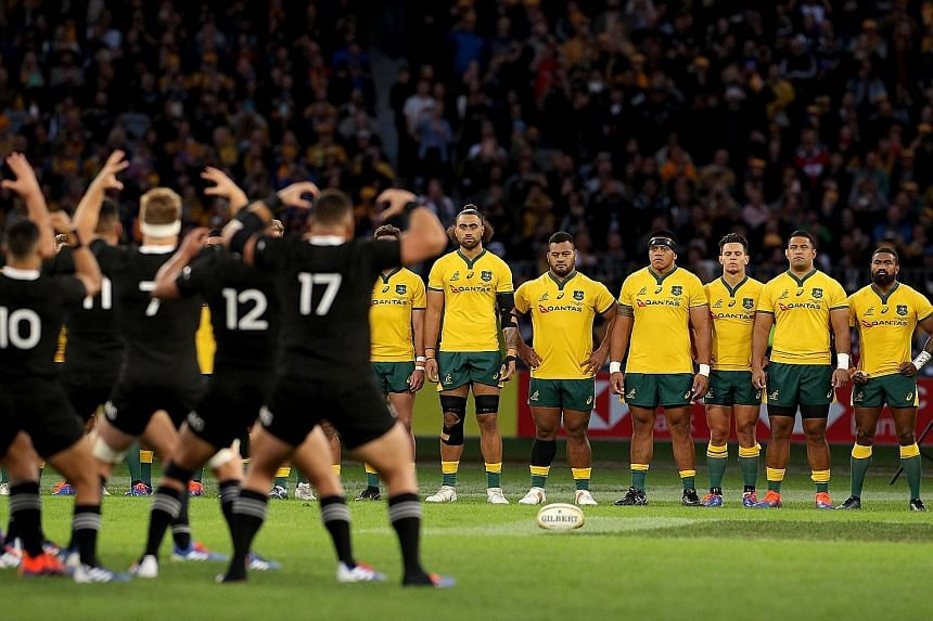 The Wallabies looking on as the All Blacks perform their famed Haka before their Bledisloe Cup match at the Perth Stadium on Saturday.