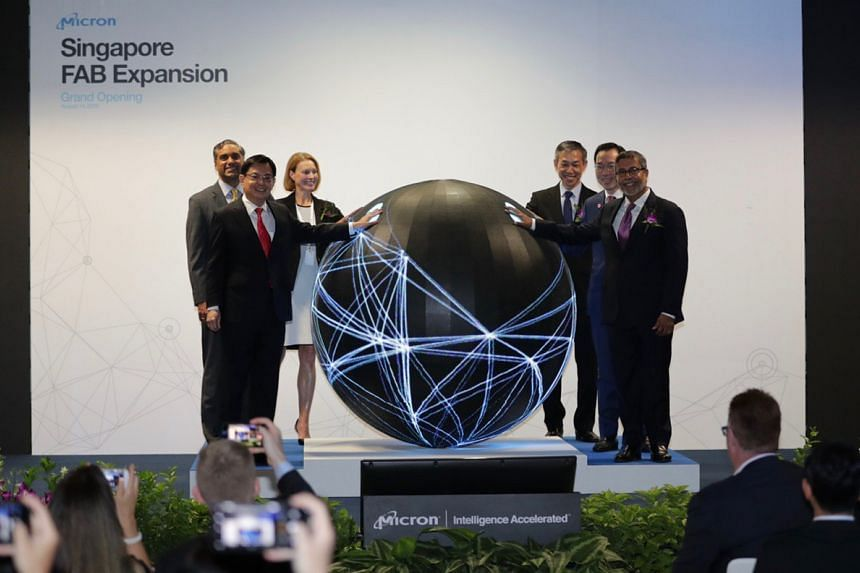 Deputy Prime Minister and Minister for Finance Heng Swee Keat (left) was speaking at the opening of the new and expanded facility of semiconductor manufacturing firm Micron Technology in North Coast Drive on Aug 14, 2019.