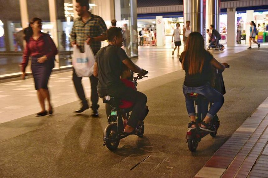 In this photo taken on Aug 5, personal mobility riders ride within the common space at Tampines Central Shopping Street.