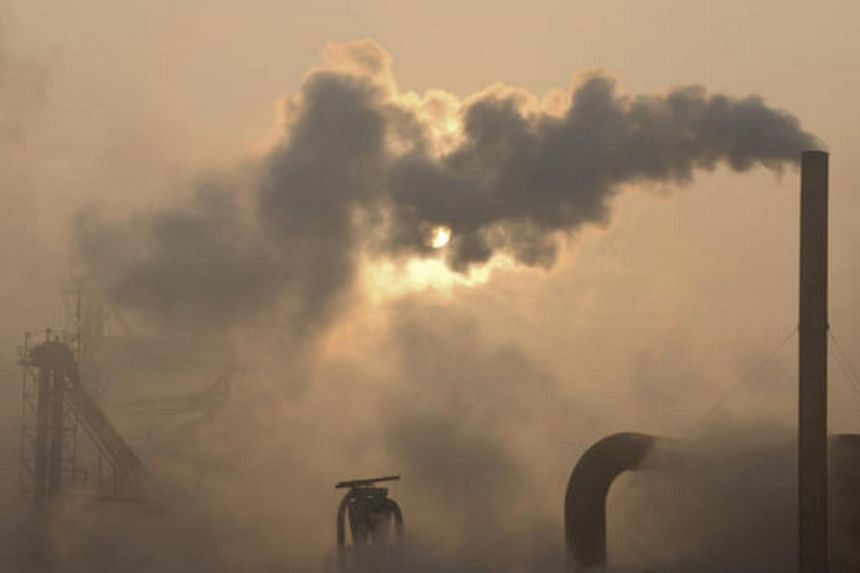 In this photo taken on Jan 17, 2013, smoke is emitted from chimneys of a cement plant in Binzhou, China.