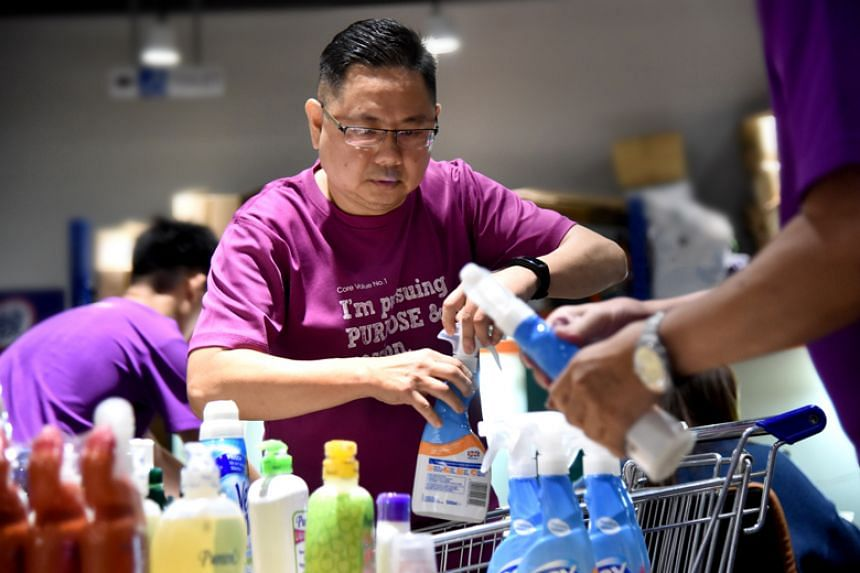 Mr Loo Poh Thye, who works part-time at social enterprise GobblerCo, packing and distributing groceries. A stroke two years ago affected the left side of Mr Loo's body and he underwent two years of rehabilitation.
