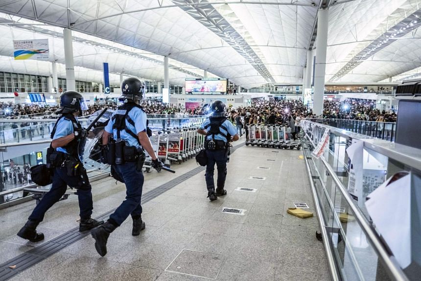 Police move in against protesters at the Hong Kong International Airport on Aug 13, 2019.