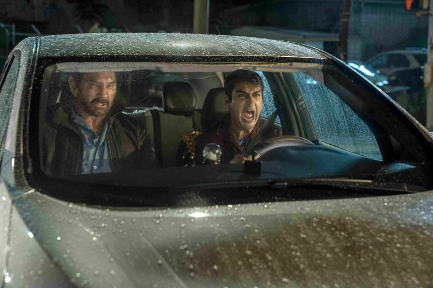 Still from the film Stuber starring Kumail Nanjiani (right) and Dave Bautista.