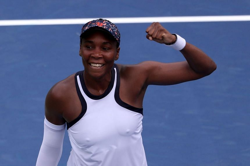 Williams celebrates match point over Kiki Bertens of the Netherlands.