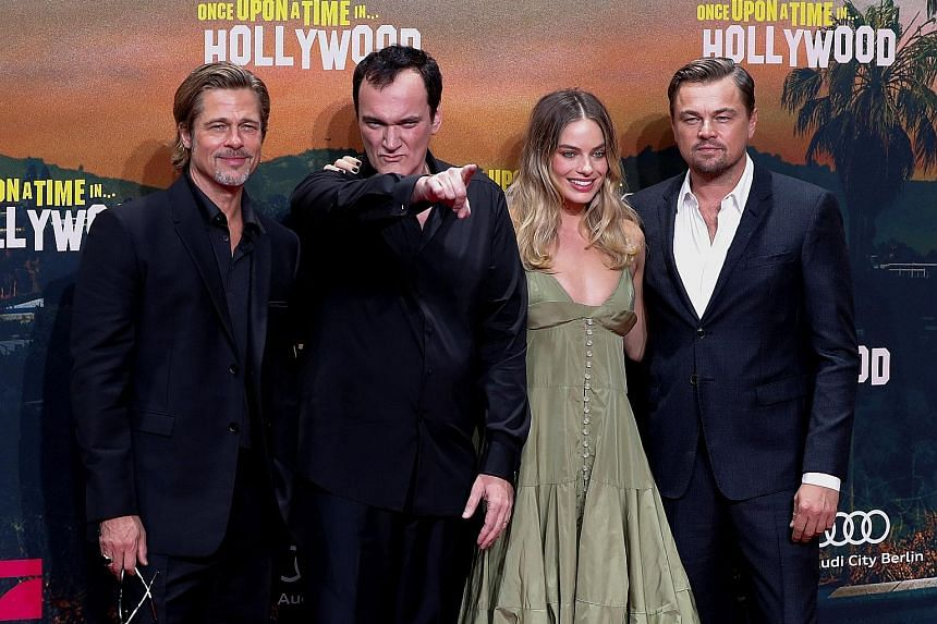 Director Quentin Tarantino (above, second from left) with actors (from left) Brad Pitt, Margot Robbie and Leonardo DiCaprio, who all star in Once Upon A Time In... Hollywood (top).