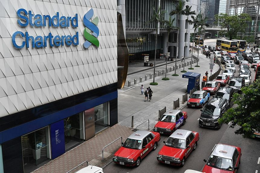 Above: Mr Didier von Daeniken, StanChart's global head for private banking and wealth management, says hitting US$100 billion in private banking assets can help the bank to attract talent. Right: A StanChart branch in Hong Kong. Mr Daeniken says prot