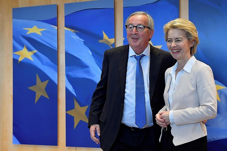 European Union president-elect Ursula von der Leyen with her outgoing predecessor, Mr Jean-Claude Juncker. She is trying to accommodate the competing demands of different political parties to make sure her team survives a confirmation vote by MEPs in