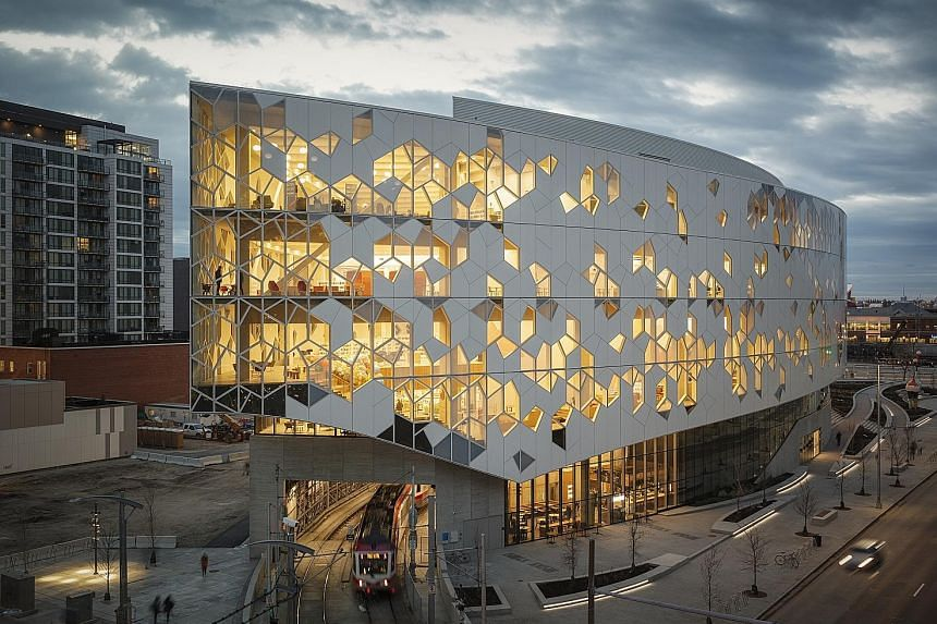 The Calgary New Central Library in Canada has train tracks running through it.