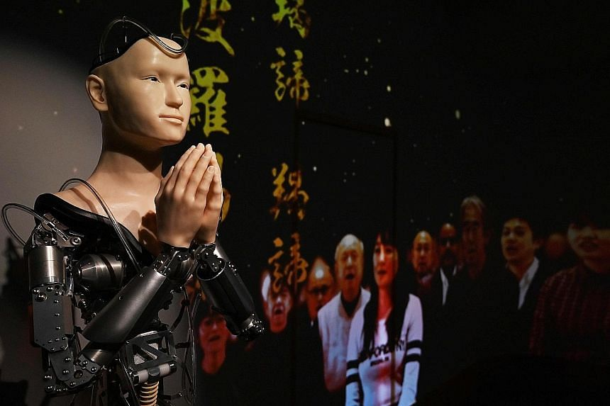 Mindar, the robot priest, is able to move its torso, arms and head. But only its hands, face and shoulders are covered in silicone to replicate human skin. Wiring and blinking lights fill the cranial cavity of its open-top head and snake around its g