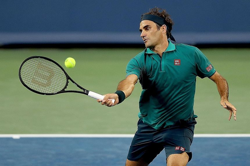 Roger Federer hitting a return to Juan Ignacio Londero. He won in straight sets to progress to the third round in Cincinnati. PHOTO: AGENCE FRANCE-PRESSE