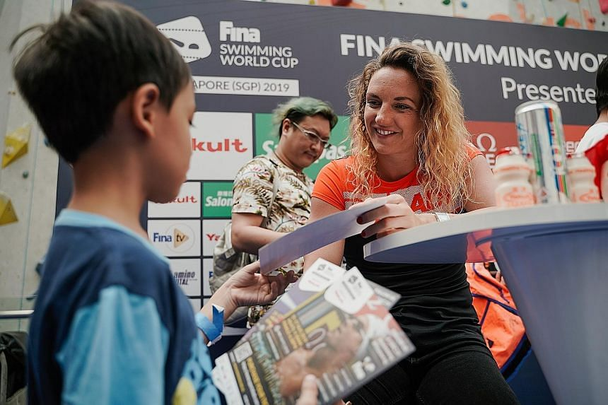 Katinka Hosszu with a young fan during a meet-and-greet session at Kallang Wave Mall. The Hungarian is in town for the Singapore leg of the Fina Swimming World Cup. ST PHOTO: ONG WEE KIAT