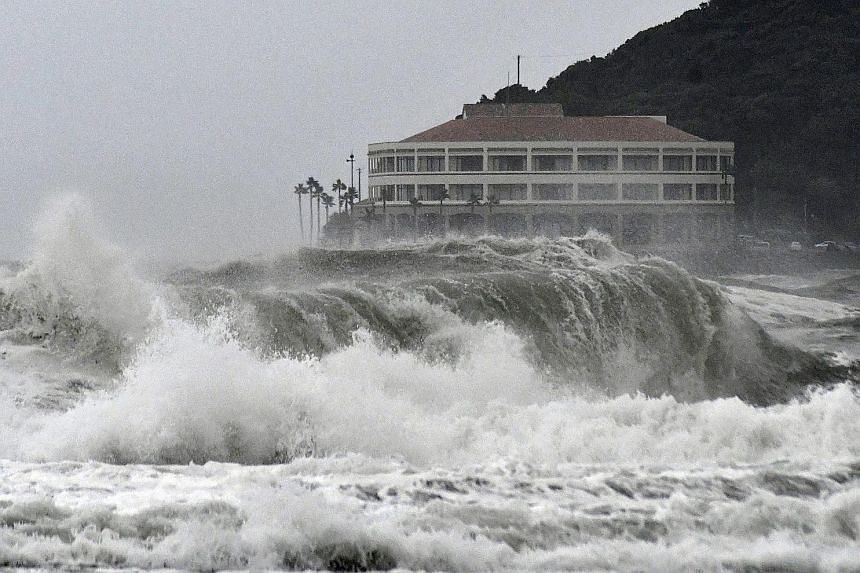 High waves pounding a beach in Miyazaki, south-western Japan, on Tuesday as tropical storm Krosa approaches the country, causing disruptions to hundreds of flights and bullet train services.