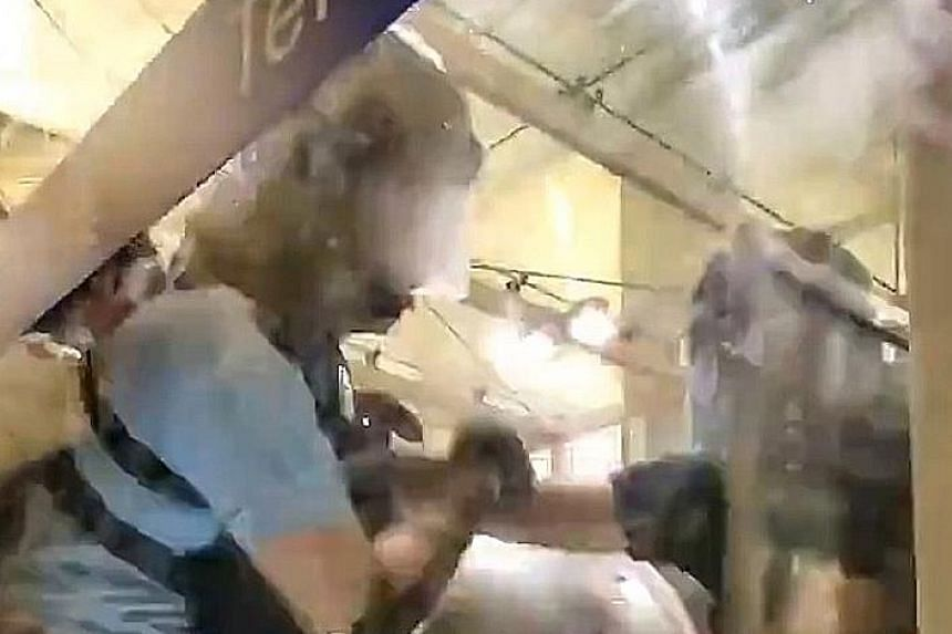 A video of a Hong Kong police officer pulling his gun on protesters after they surrounded him, took his baton and beat him with it, has gone viral on Twitter. The video, filmed by Wall Street Journal reporter Mike Bird and posted on his Twitter accou