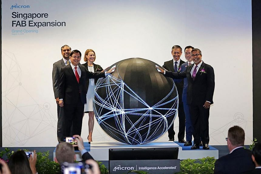 Deputy Prime Minister and Minister for Finance Heng Swee Keat and Micron president and CEO Sanjay Mehrotra (far right) at the opening of Micron's expanded facility yesterday. With them are (from left) Micron executive vice-president of global operati