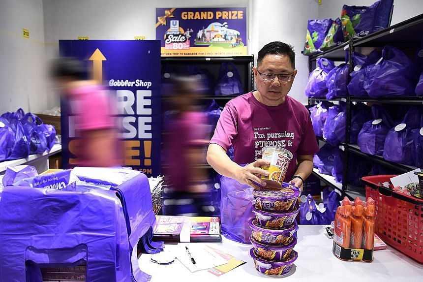 Mr Loo Poh Thye, 52, who suffered a stroke two years ago, now works part-time with social enterprise GobblerCo, packing and distributing groceries.