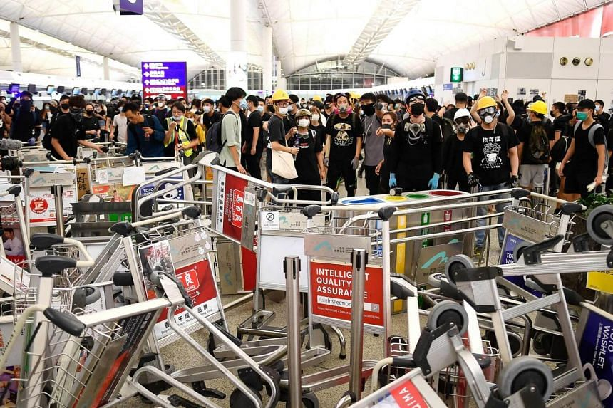 Demonstrators largely retreated from the airport on Aug 14, 2019, after two chaotic days in which hundreds of flights were cancelled.