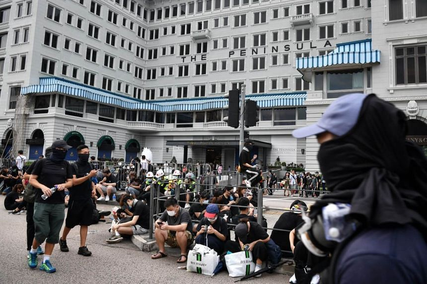 In a picture taken on Aug 3, 2019, protesters are seen outside The Peninsula hotel in Hong Kong.
