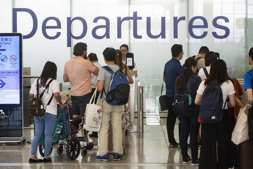 Passengers at departure gates in Hong Kong's international airport on Aug 14, 2019.