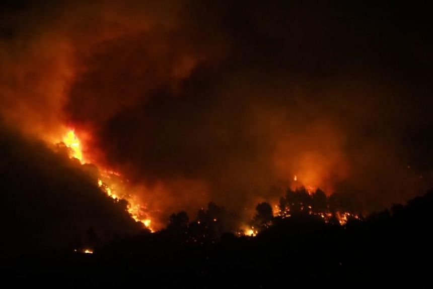 Some 900 hectares have been destroyed since the fire broke out in the rugged hills of the Aude department, about 100km south-east of Toulouse, on Aug 14, 2019.
