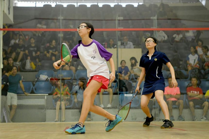 National Junior College's Dayna Choy (left) and Methodist Girls' School's Joy Ong in action during the girls' C Division squash final on Aug 15, 2019.