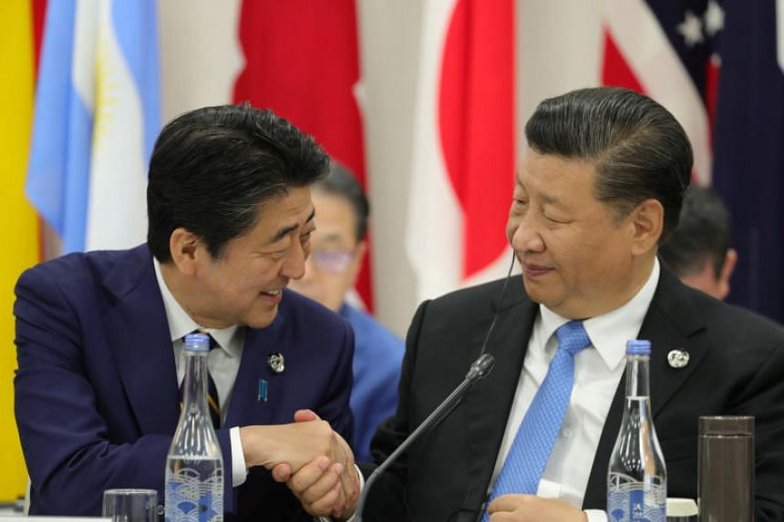 Japan's Prime Minister Shinzo Abe with China's President Xi Jinping during the G-20 summit in Osaka, Japan, on June 28, 2019.
