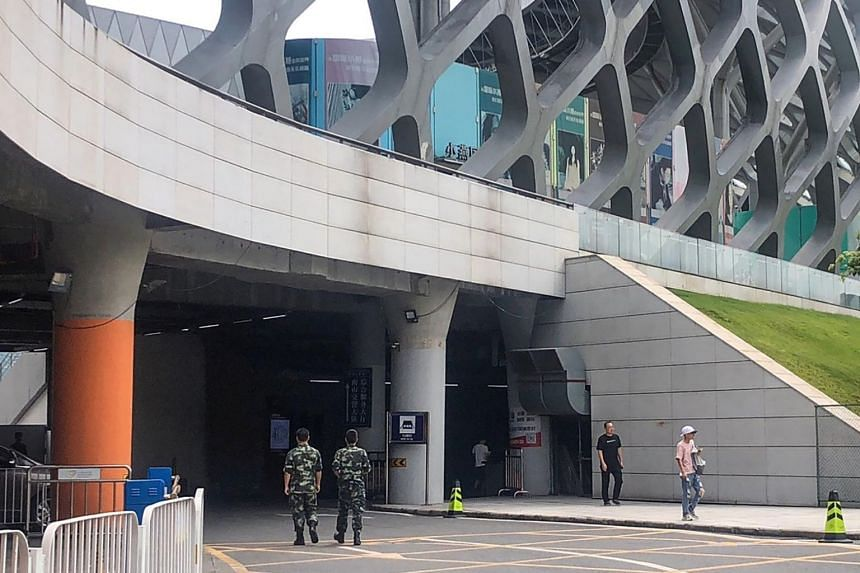 Chinese military personnel walk at the Shenzhen Bay stadium on Aug 15, 2019.
