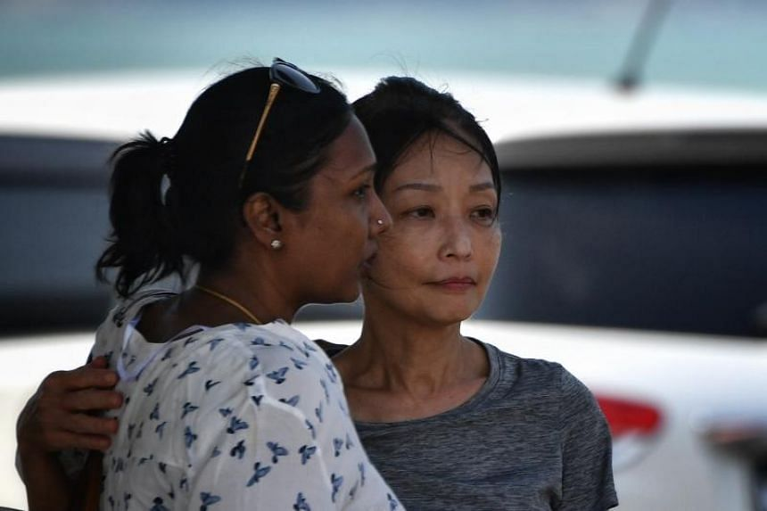 Mr Tan Eng Soon's wife, Madam Kwan Yoke Yee, with a consular officer at Penyabong Jetty in Mersing on Aug 14, 2019.