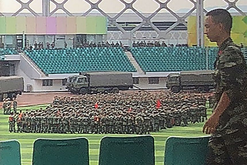 Chinese military personnel gather at the Shenzhen Bay stadium in Shenzhen, bordering Hong Kong in China's southern Guangdong province, on Aug 15, 2019.