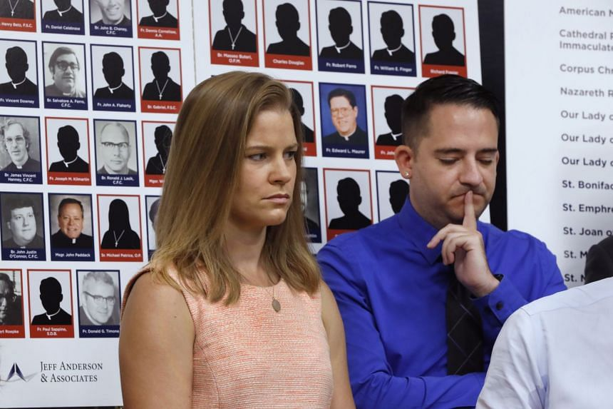 Sexual abuse victims Bridie Farrell and Joseph Caramanno listen during a news conference in New York, Aug 14, 2019.